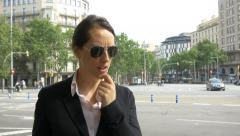 4k secret agent woman police dark glasses city centre surveillance security Stock Footage