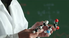 Stock Video Footage of Chemistry teacher holding molecular model, close up