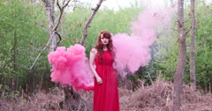 Red hair woman wearing dress surrounded by smoke Stock Footage