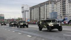Military vehicles traveling through the city, Hummers, infantry, Russian army Stock Footage