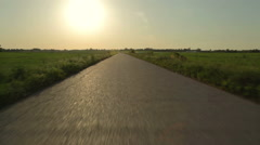 Driving on an empty asphalt road at sunset HD 24 fps Stock Footage