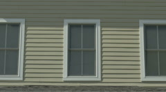 Beige House straight on shot with windows - stock footage