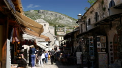 Tourists in the narrow street of Mostar Bosnia and Herzegovina Stock Footage