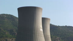 Two nuclear cooling towers from low angle Stock Footage