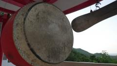 Kick the Gong in Asian Chinese temple Stock Footage