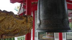 Kick the Gong Bell in Asian Chinese temple Stock Footage
