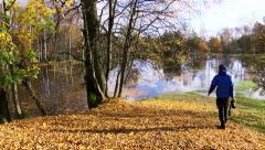 Nature Photographer Capturing Floods In Autumn Stock Footage