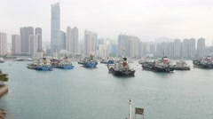 Moorage area in front of Tsuen Wan Town, from the top, panning shot Stock Footage