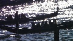 Gondolas in shiny waves Stock Footage