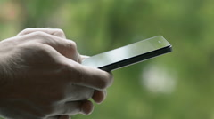 Close-Up Man Writes A Message On Smart-Phone Stock Footage