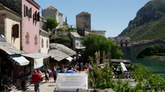 Pan from tourism to the Stari Most (Old Bridge) Mostar Bosnia and Herzegovina Stock Footage