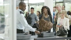 4K Airport security guards on duty, searching passengers before a flight - stock footage
