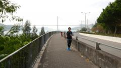 Runner on the beautiful seafront path, sideway of embankment Stock Footage