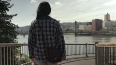 Young Woman Walks Down Path Toward Waterfront Park (Slow Motion) Stock Footage