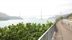 Panning out the panoramic view to channel, Ting Kau Bridge and Tsing Yi island Stock Footage