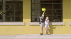 Girls Try To Pose With A Smiley Face Balloon, But It Blows In The Wind, Funny Stock Footage