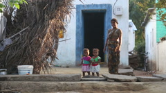 Woman standing with two small children. Stock Footage
