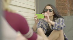 Teens Hang Out And Take Turns Taking Photos Of Each Other (Slow Motion) Stock Footage
