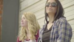 Teen Girls Hang Out Together On A Loading Dock, Cool, Edgy, Style (Slow Motion) Stock Footage