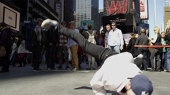 Asian kid Yankees hat windmills Times Square breakdancing slow motion 4K NYC Stock Footage