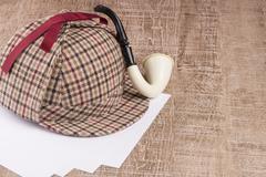 Sherlock Hat and Tobacco pipe - stock photo