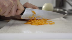 Home cook chopping carrots. 4K UHD. Stock Footage
