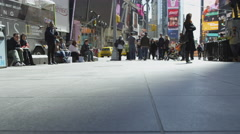 People walking Times Square low angle tourists New Yorkers sunny day slow 4K NYC Stock Footage