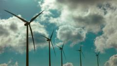Wind mill turbines site on mountain timelapse with cloudy sky Stock Footage