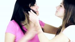 Women fighting holding hair angry slow motion Stock Footage