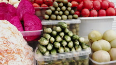 Assortment of pickled vegetables at a farmers market in Pyatigorsk, Russia Stock Footage