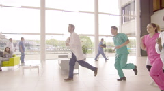 4K Medical team running through hospital building, responding to an emergency Stock Footage