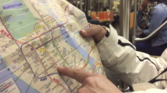 Using map in the subway in NYC Stock Footage