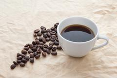 Coffee With Coffeebeans Stock Photos
