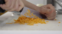 Home cook dicing carrots. 4K UHD. Stock Footage