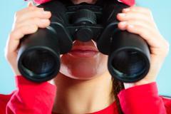 Stock Photo of lifeguard on duty looking through binocular