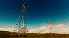 Electricity,high voltage pylons,power transmission lines,cinematic grade Stock Footage