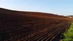 4K Freshly Ploughed Field near Village Stock Footage