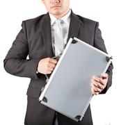 business man holding metal strong briefcase isolated white background - stock photo