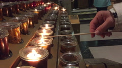 Woman Hand Lighting A Votive Candle In A Church Stock Footage
