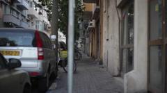 Sidewalk in florentine neighborhood, Tel-Aviv, Israel Stock Footage