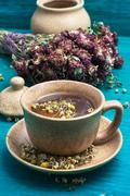tea brewed with chamomile in ceramic mugs - stock photo