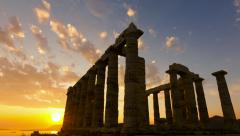 Golden sea sunset Ancient Temple of Poseidon Sounio Greece 25p Stock Footage