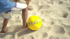 Kids playing soccer on a beach in Brazil - stock footage