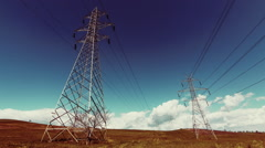 Electricity,high voltage pylons,power transmission lines,cinematic grade - stock footage
