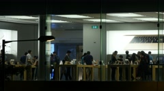People attend Apple store promotion show room in Hong Kong. Stock Footage