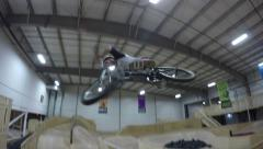 bmx rider big barspin in skatepark - stock footage