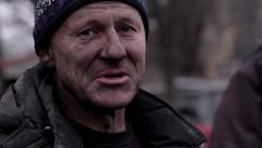 Revolutionist tells about struggle for freedom. Tramp with a dirty face. Stock Footage