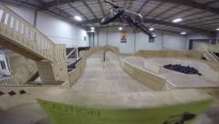 Bmx bike catches air on a ramp Stock Footage