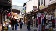 People walking in the streets of the old town of Sarajevo Bosnia and Herzegovina Stock Footage