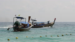 Long-tail boat with black engine smoke on Phi Phi Island - 4k Close-up Stock Footage